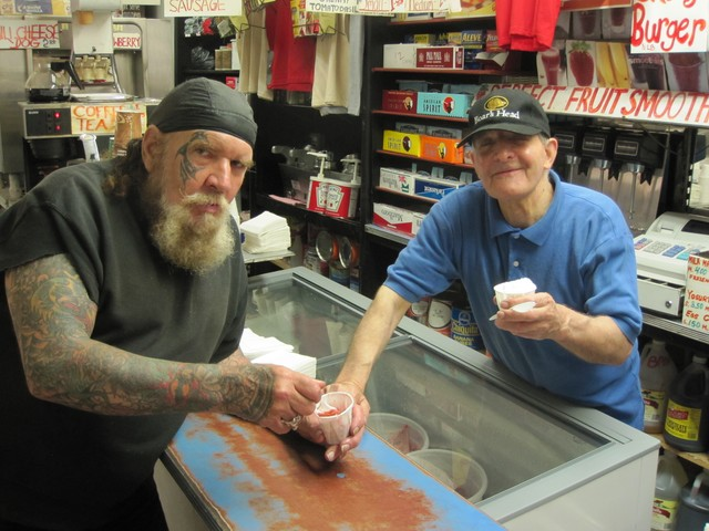 Alvarez and longtime friend Biker Bill enjoyed a taste of the shop's new Italian ice offerings last year.