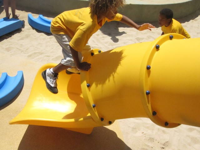 Kids even found a different way to play on one of the park's more traditional elements: a slide.