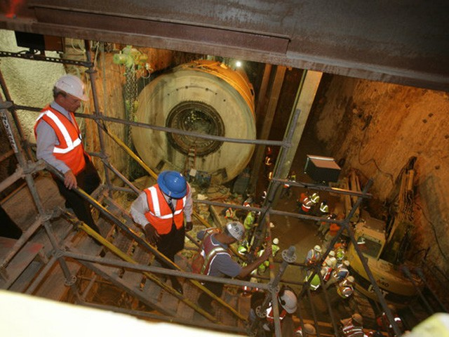 Media and city officials descend below Port Authority to where the boring machines were set to break through.