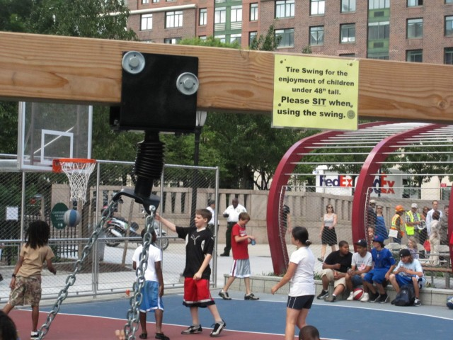 A new sign warns that the swing is only for kids under 48 inches tall.