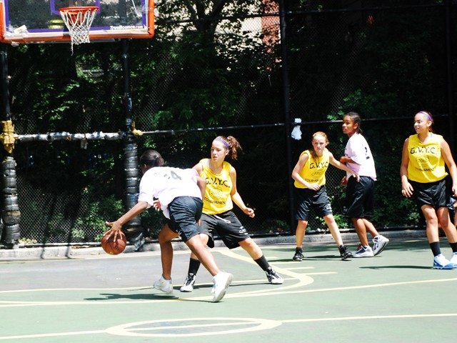 The Greenwich Village Youth Council runs the West Fourth Street Basketball Championships in the world famous Cage. Here, girl's teams Mika and the NYC Lady Warriors face off at The Cage.