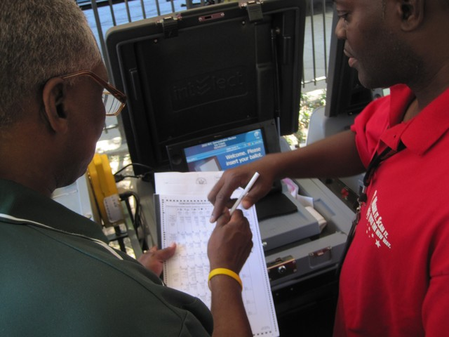 Assemblyman Keith Wright gets a demonstration of the new voting machines.
