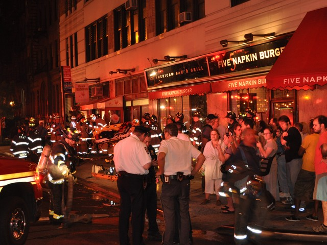 Evacuated tenants and passerby gathered at 45th and Ninth Avenue to watch firefighters battle the blaze.