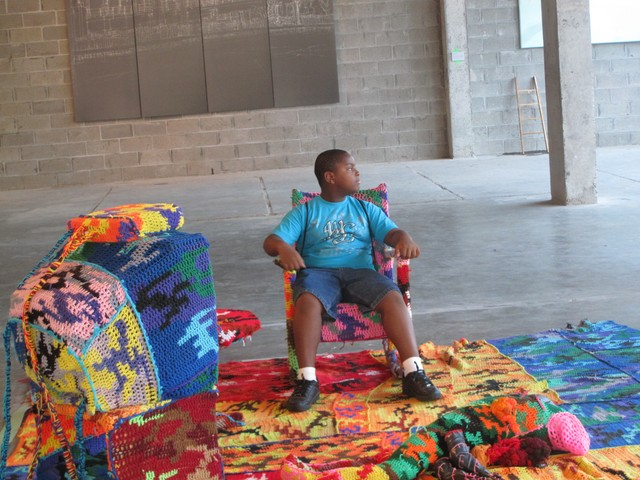 Paul Gaston, 11, sits in one of the interactive exhibits.