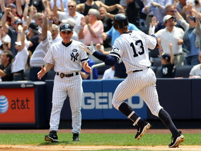 Alex Rodriguez #13 of the New York Yankees rounds the bases after hitting the 600th home run of his career in the first inning as first base coach Omar Malave #52 reacts against the Toronto Blue Jays on August 4, 2010 at Yankee Stadium.