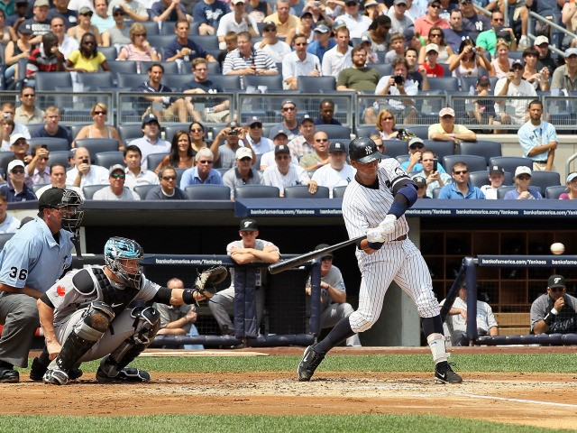 Alex Rodriguez #13 of the New York Yankees connects on his 600th career home run in the first inning against the Toronto Blue Jays on August 4, 2010 at Yankee Stadium in the Bronx borough of New York City.