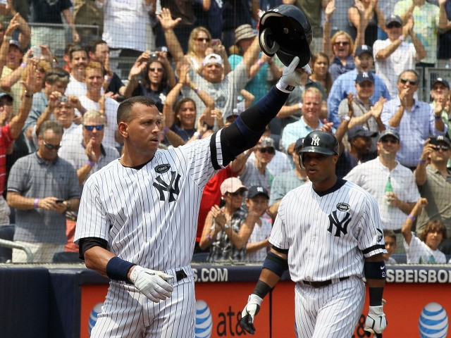 Alex Rodriguez salutes the crowd after hitting his 600th career home run in the first inning against the Toronto Blue Jays as teammate Robinson Cano #24 looks on on August 4, 2010 at Yankee Stadium.