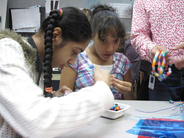 Kalsoom Ali and Valerie Liranzo got busy with beads at the Jewish Guild of the Blind's art class.