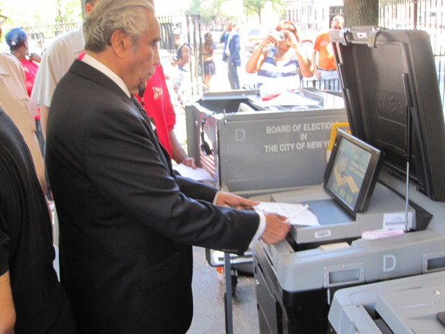 Rep. Charles Rangel gets a demonstration of how to use the new voting machines.