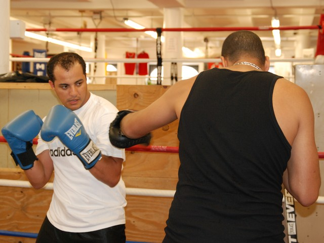 Karim Ahmed, 27, trains with instructor Emad Ali twice a week.