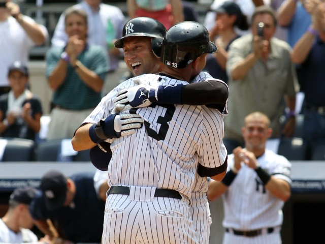 Alex Rodriguez of the New York Yankees celebrates with teammate Derek Jeter after hitting the 600th home run of his career in the first inning against the Toronto Blue Jays on August 4, 2010 at Yankee Stadium.