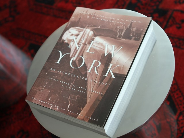 The apartment is filled with complimentary books about New York.