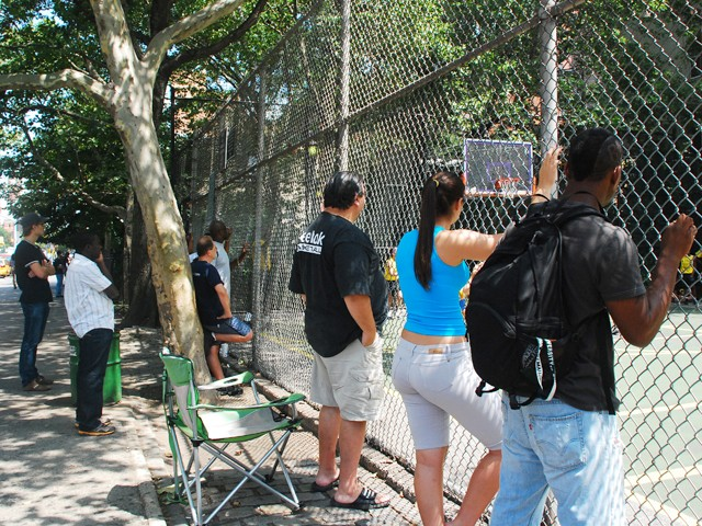 Spectators watch girl's teams Mika and the NYC Lady Warriors face off at The Cage.