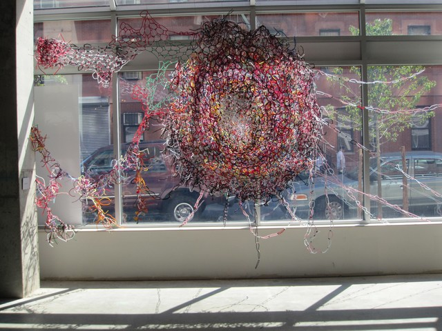 An exhibit by artist Blanka Amezkua is made of entwined pipe cleaners and encourages visitors to touch.