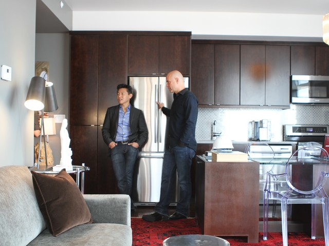 HGTV designers Vern Yip and Jack Thomasson stand in the kitchen/foyer of the million dollar condo.