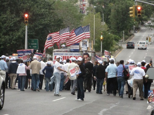 The large Espaillat-Linares group marches north on Broadway.