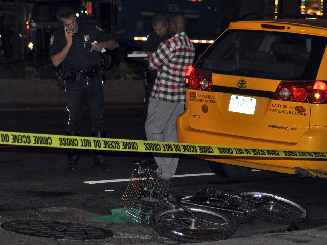 A deliveryman was struck by a cab while riding his bike at 92nd Street and Broadway Sunday night.