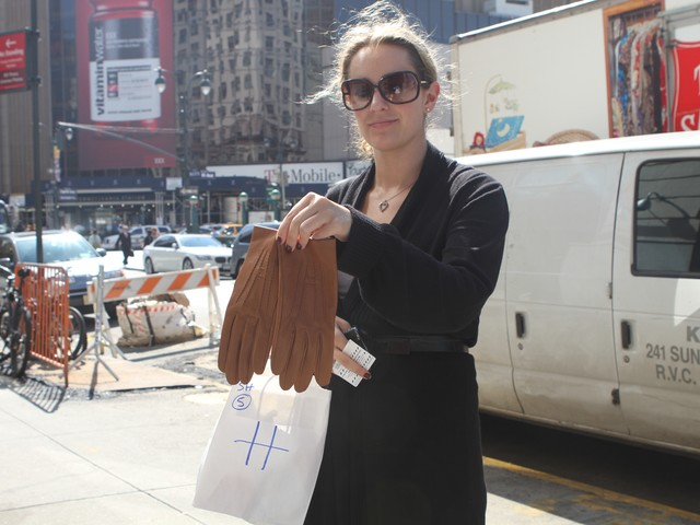 Graduate student Jen Jenicka, 26, shows off her new Hermes purchase from Wednesday's sample sale.
