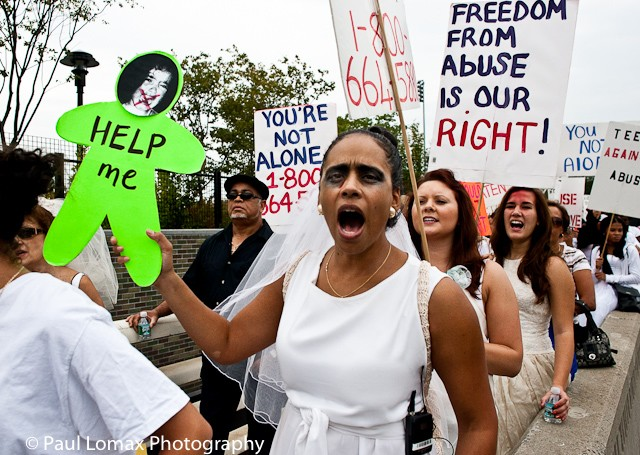 Hundreds of people marched in the 10th annual Brides March Against Domestic Violence on Sunday.
