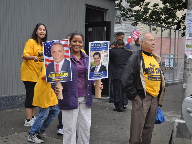 The wife of Juan Hidalgo, Male State Committee candidate for the 72ndAssembly District, campaigns for Levine and her husband.