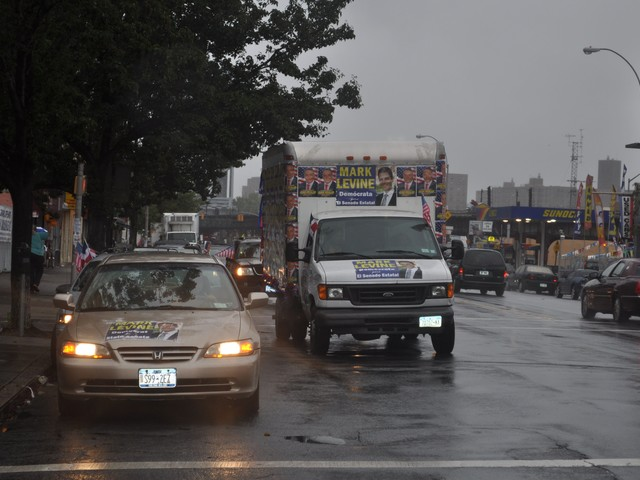 The Levine caravan drove through Inwood and Washington Heights in the rain.