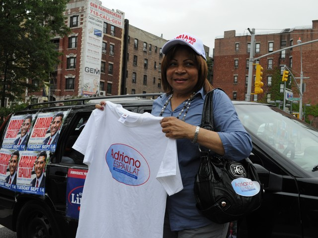 An Espaillat supporter shows her spirit.