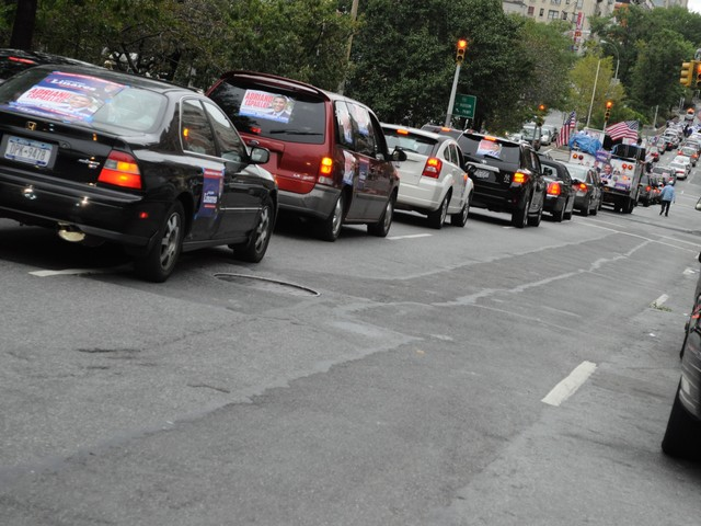 The Linares-Espaillat caravan stretched at least three blocks.