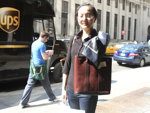 Shopper Pauline Pan shows off her new bag and scarf that she bought at the Hermes sample sale Wednesday.