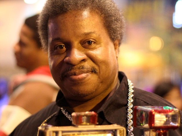Harlem local Billy Hemmons, who's been coming to Amateur Night with the same camera for 20 years.