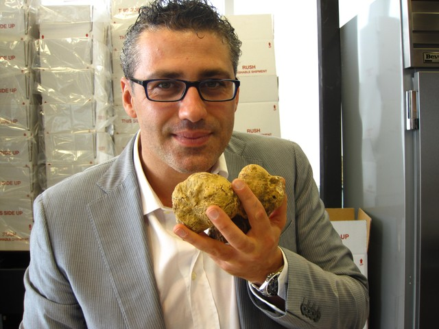 Urbani Truffles vice president Vittorio Giordano inhales the heady scent of truffles, which he says he
