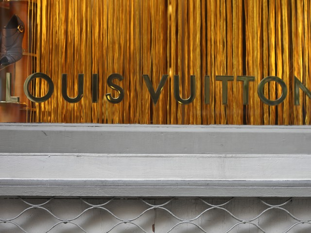 Two teams worked amidst shoppers at the Louis Vuitton store.