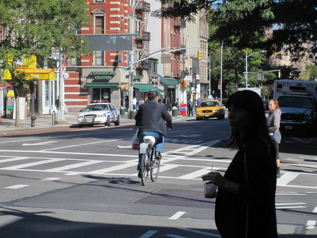 As Stringer spoke, this cyclist rode by - in the wrong direction.