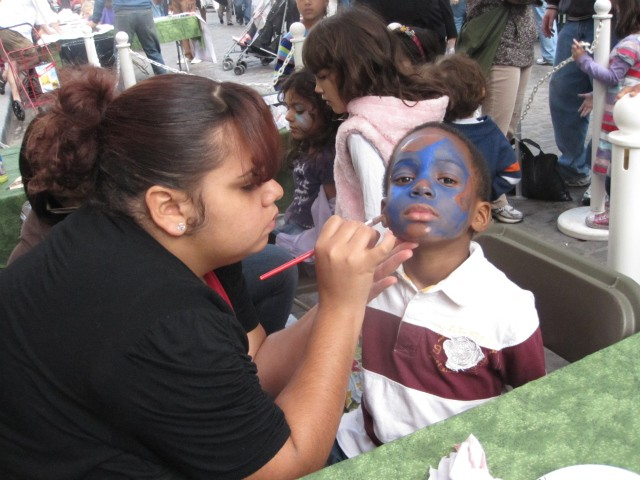 Nekia Bland, 5, a Brooklyn resident, got his face painted like a globe.