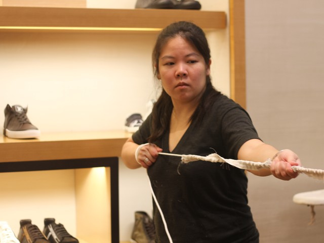 Lea Kulapaditharom, 34, pulls at a rope of Louis Vuitton fabric.