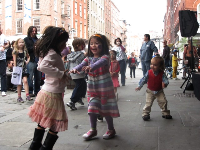 Children danced in front of the stage on Front Street while the band Supercute! played.