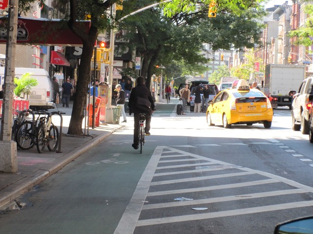 A cyclist uses a bike lane on Second Ave. in the East Village.