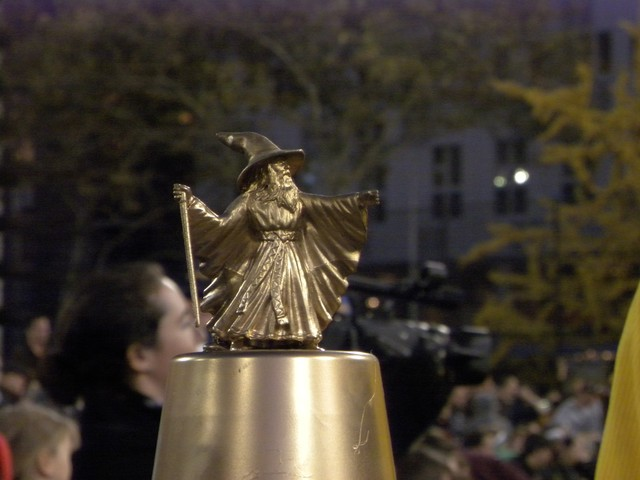 A miniature sorcerer stood atop the championship trophy.