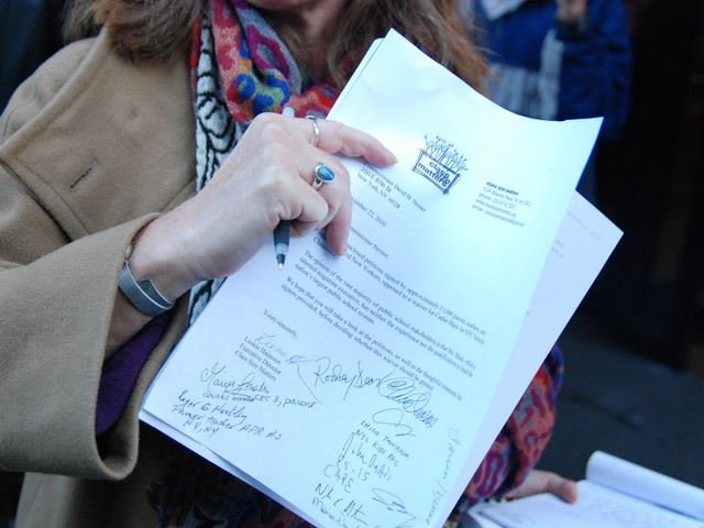 The group delivered 13,000 signatures urging Commissioner Steiner to deny the waiver request.