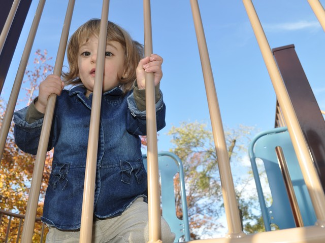 Two-year-old Clementine Minter climbs the jungle gym.