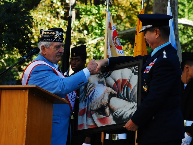 Sal Scarlato of the Korean War Veterans Association presents a Korean General with a symbol of the bond between Korea and the US.
