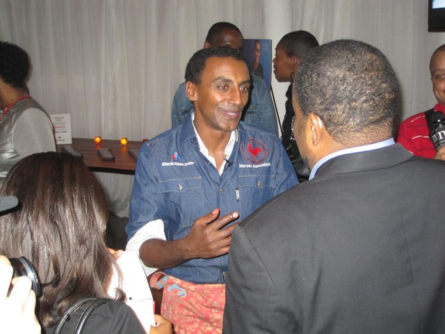 Marcus Samuelsson works the crowd at his Red Rooster Harlem restaurant.