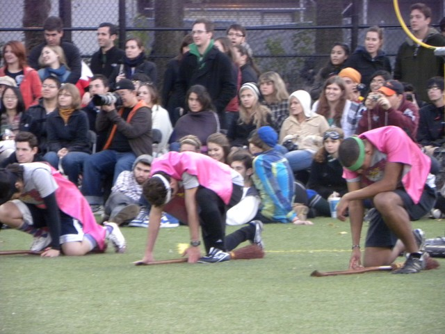 Like dodgeball, ground quidditch begins with players running to capture balls in the center of the field.