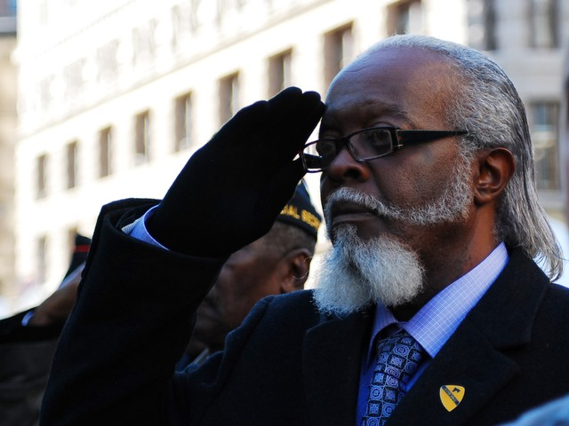 Vietnam veteran and gubernatorial debate superstar Jimmy McMillan salutes during the national anthem at the opening ceremony for the 91st annual New York City Veteran's Day Parade Thursday.