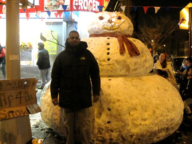 Jackman Suarez builds a snowman on the corner of 169th Street and Audubon Avenue every year.