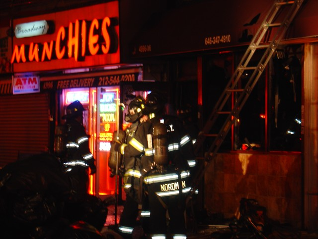 The fire gutted a storefront and apartment and caused smoke damage next door.