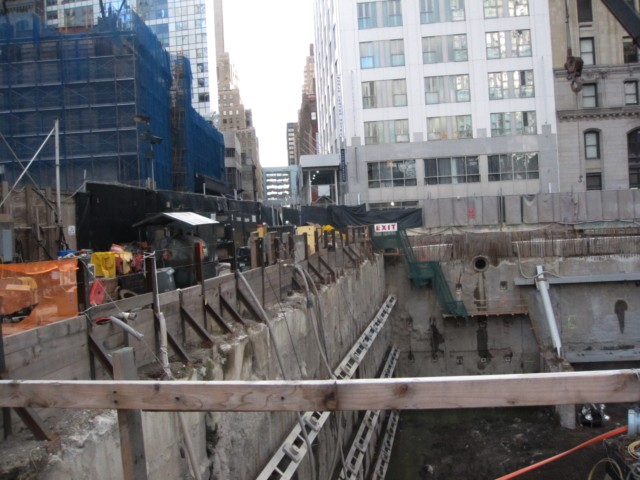 The former site of St. Nicholas, which the Port Authority has excavated for a belowground parking garage for the World Trade Center. The Deutsche Bank building, which is being demolished, is at left.
