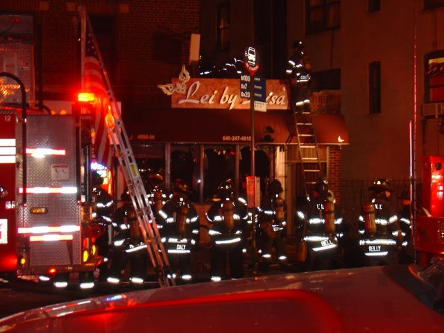 Firefighters responded to the fire late Thursday night, closing off Broadway and diverting traffic to Tenth Avenue.