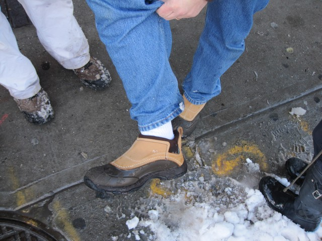 Jerry Feldman shows off the boots that brought him through the slush.