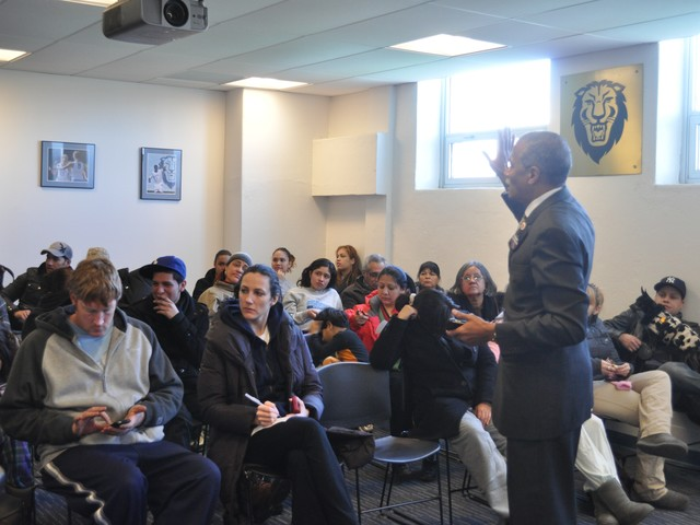 City Councilman Robert Jackson spoke to residents of 510 W. 218th Street about available services and when they might be able to return to their homes.