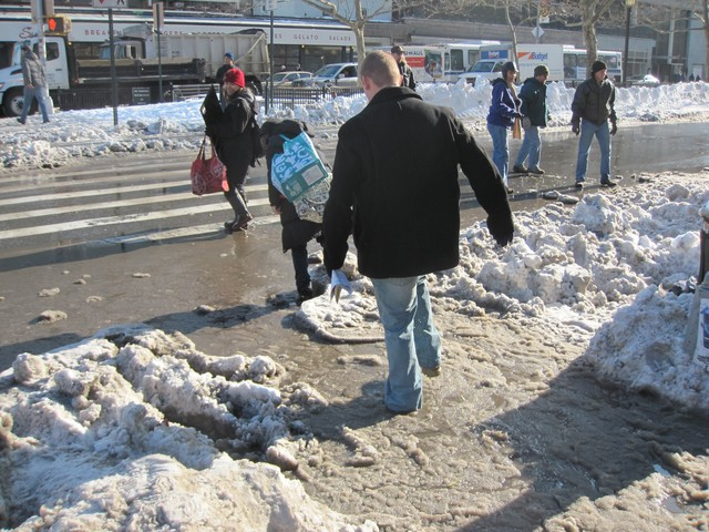 Boot-wearing passersby had no trouble dealing with the slush.